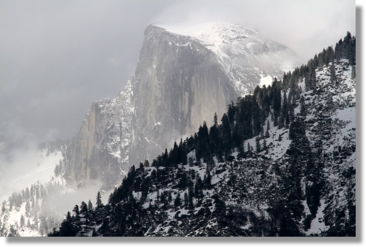 Half Dome, storm clouds, and mist